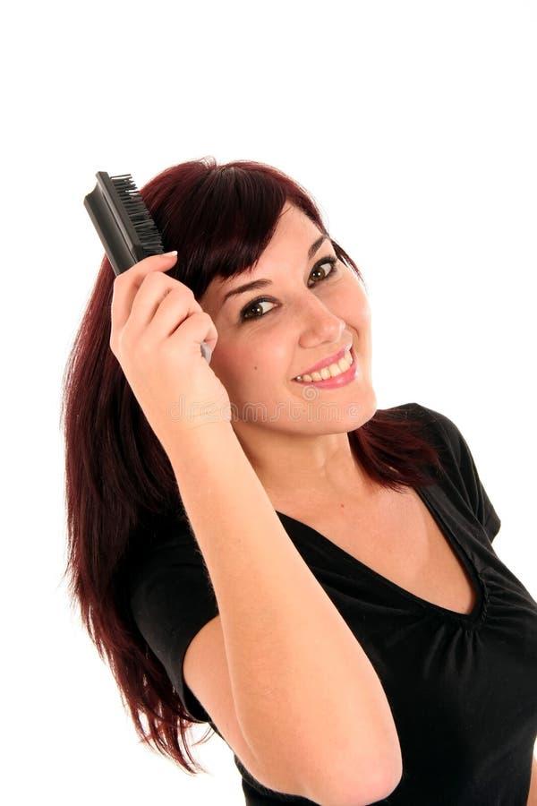 borsta nätt kvinna för hår arkivfoto