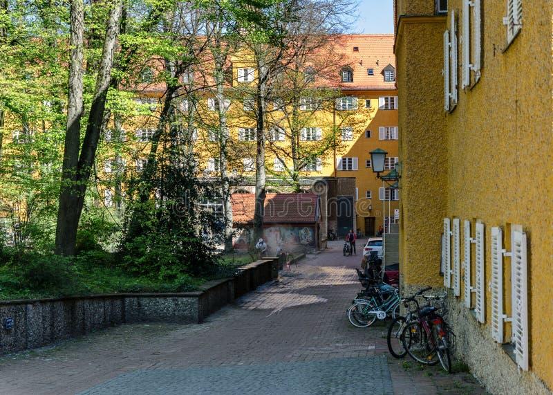 Borstay omr?de, Munich, Tyskland per fantastiskt omr?de av staden, husen och borgg?rdarna arkivbilder