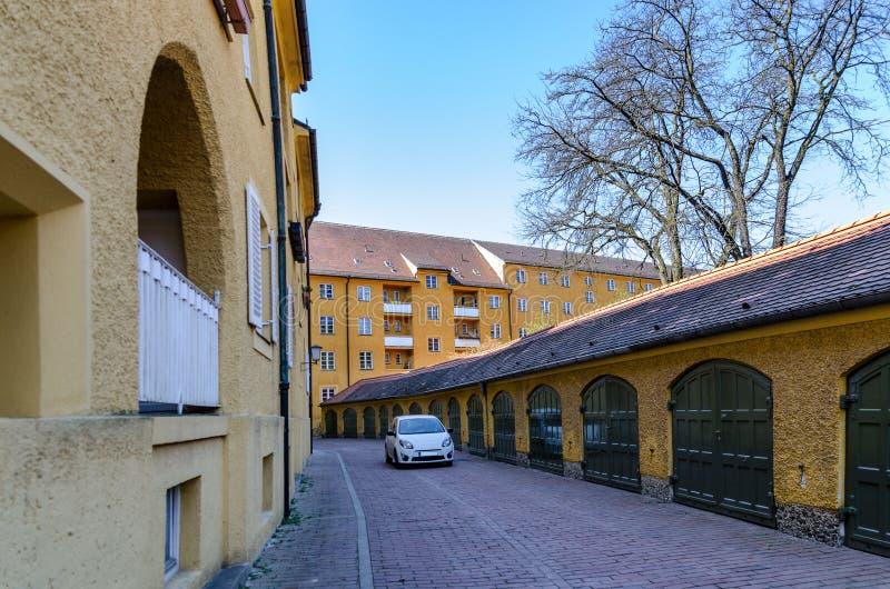 Borstay omr?de, Munich, Tyskland per fantastiskt omr?de av staden, husen och borgg?rdarna arkivbild