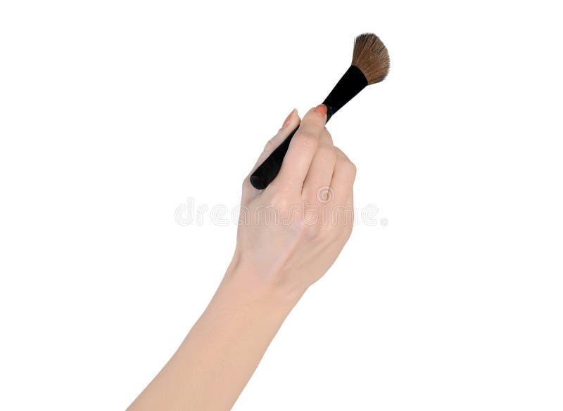Borste för makeup för kvinnahand hållande fotografering för bildbyråer