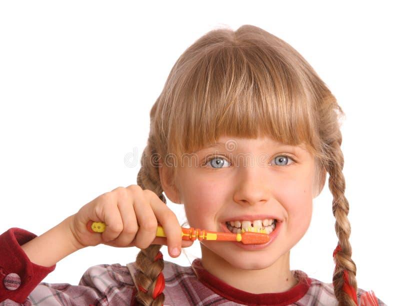 borstebarnet gör ren tänder för ett s royaltyfri bild