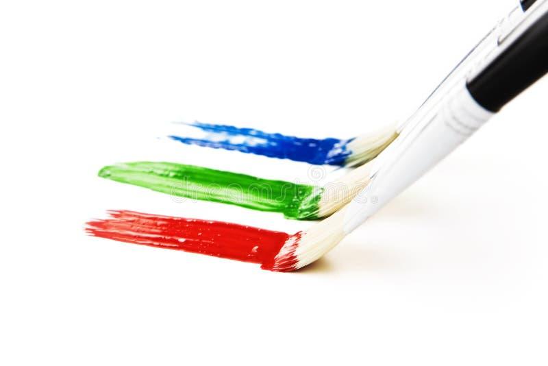 borstefärger som målar tre arkivfoto