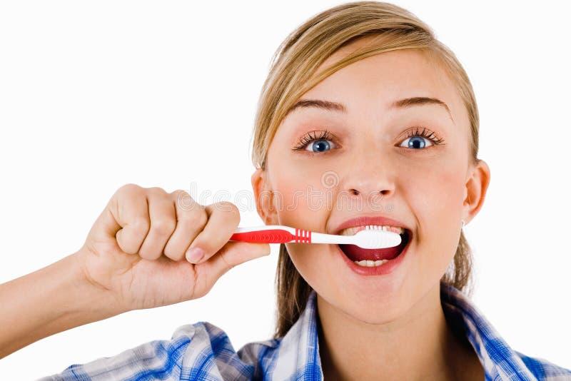 borsteflicka henne tandbarn royaltyfri bild