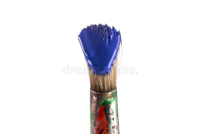 Borstel met blauwe verf stock afbeeldingen