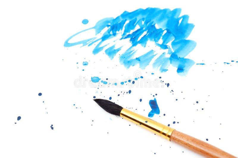 Borstel met blauwe verfslag en stok stock foto