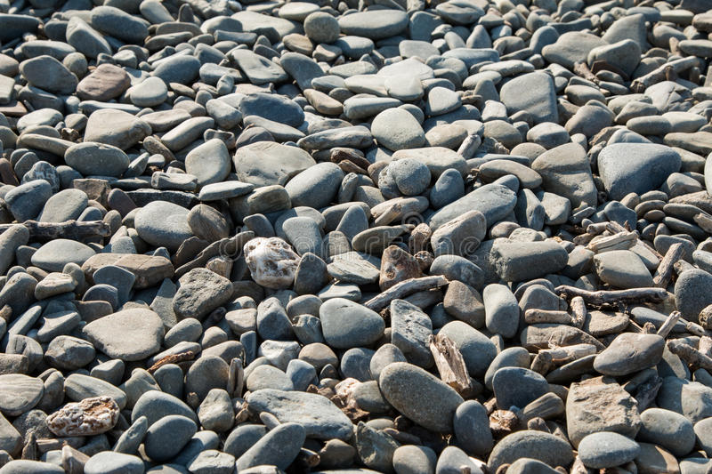 Borth Beach Stones 5. Borth beach stones, close up photograph of some of the stones on Borth beach in Mid Wales, large medium and small stones or pebbles stock image