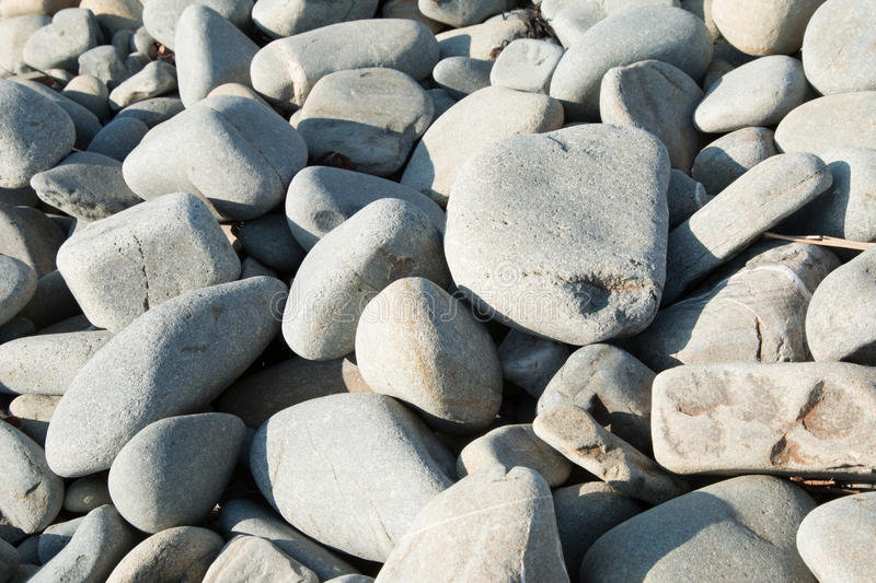 Borth Beach Stones. Close up photograph of some of the stones on Borth beach in Mid Wales, large medium and small stones or pebbles royalty free stock image