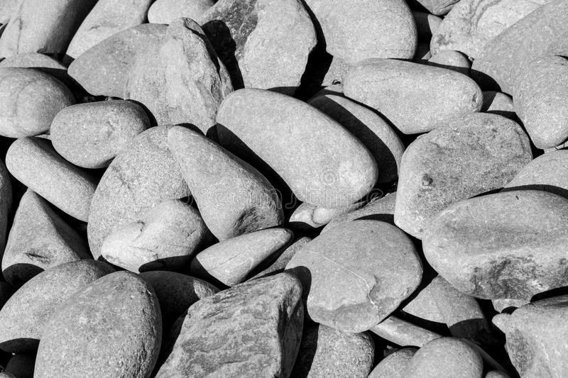 Borth Beach Stones 4. Borth beach stones, close up photograph of some of the stones on Borth beach in Mid Wales, large medium and small stones or pebbles stock images