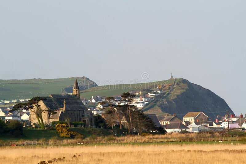 Borth church with headland in the background royalty free stock images