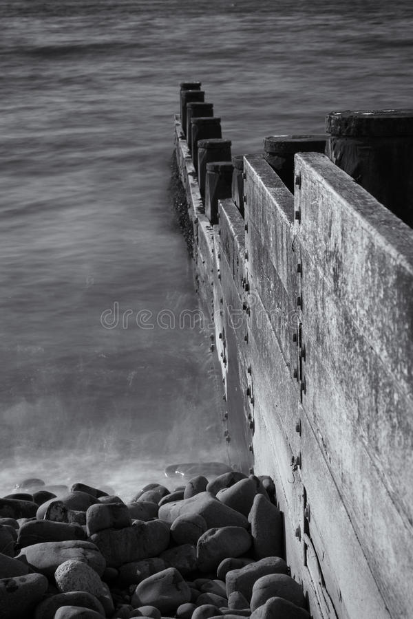 Borth Mid Wales Wooden Sea Breakers Black and White. Black and White, Borth Mid Wales Wooden Breakers showing the bolts that fasten the boards to the wooden royalty free stock images