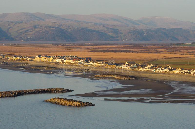 Borth. A small town on Welsh coast of Irish Sea, Cardigan Bay in the UK View of the beach, town and mountains stock photos