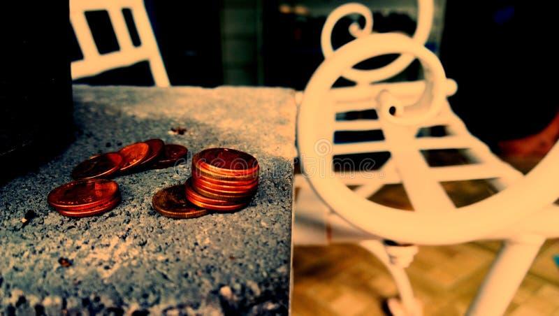 Borttappade mynt arkivfoto