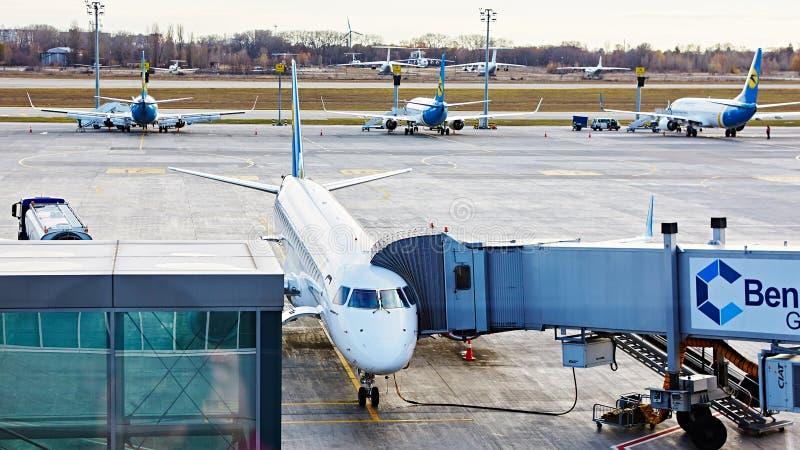 Boryspil, Ukraine. Aircraft ground handling. Boryspil, Ukraine - November 12, 2015: Aircraft ground handling in airport stock photo