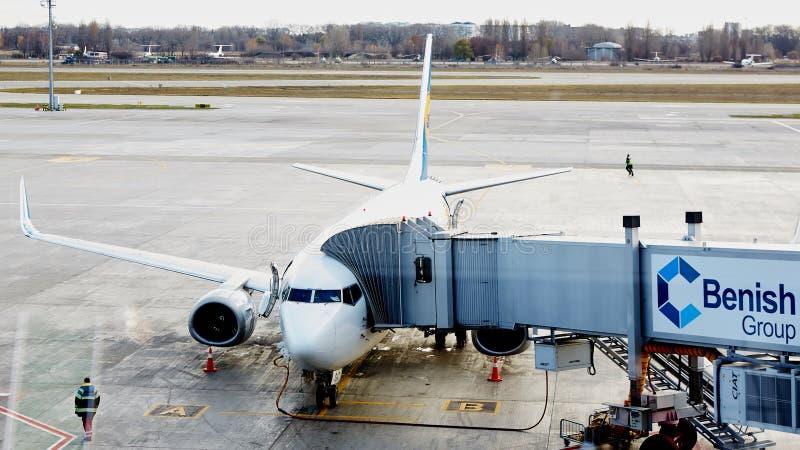 Boryspil, Ukraine. Aircraft ground handling. Boryspil, Ukraine - November 12, 2015: Aircraft ground handling in airport stock images