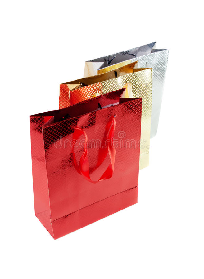 Bos kleurrijke die document zakken voor giften op wit worden geïsoleerd royalty-vrije stock afbeeldingen
