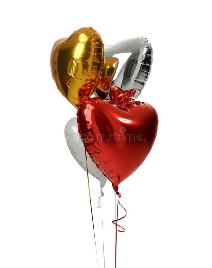 Bos van de grote witte rode zilveren en gouden voorwerpen van hartballons stock fotografie