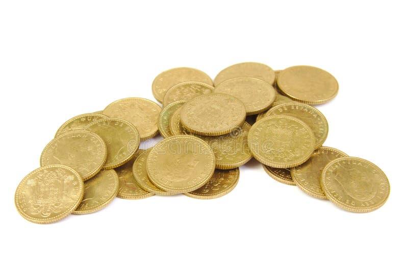 Bos van oude Spaanse muntstukken op een witte achtergrond stock afbeeldingen
