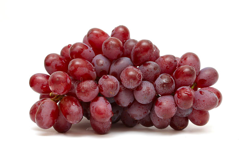 Bos van rode druiven die op wit worden geïsoleerd stock afbeelding