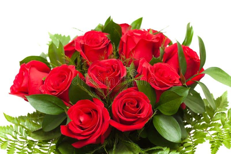Bos van rode rozen in bloemist het verpakken royalty-vrije stock foto