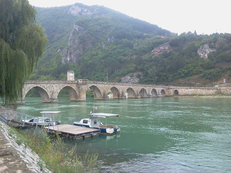 Bosnia. Lake boat green tree bridge stock images