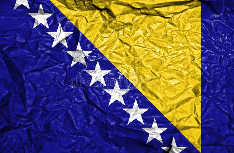 Bosnia and Gerzegovina vintage flag on old crumpled paper background stock photos