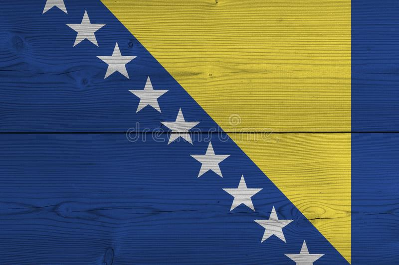 Bosnia and Herzegovina flag painted on old wood plank. Patriotic background. National flag of Bosnia and Herzegovina royalty free stock photo