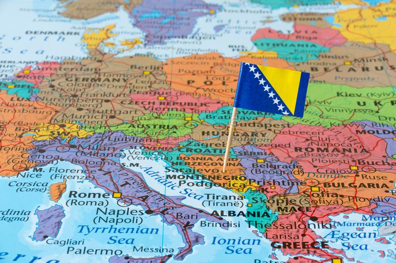Bosnia and Herzegovina map. Balkan peninsula map with paper flag of Bosnia and Herzegovina stock photo
