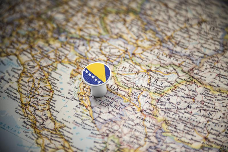 Bosnia and Herzegovina marked with a flag on the map.  stock image