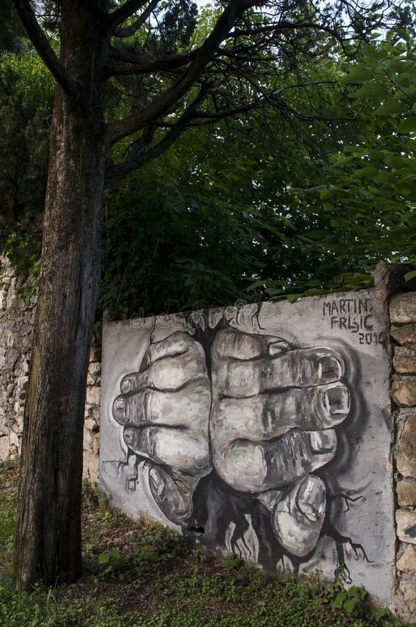Mostar, palace, bombed, graffiti, mural, Bosnia and Herzegovina, Europe, street art, skyline, Bosnian War. Bosnia, 07/07/2018: a mural on the surrounding wall of stock photos