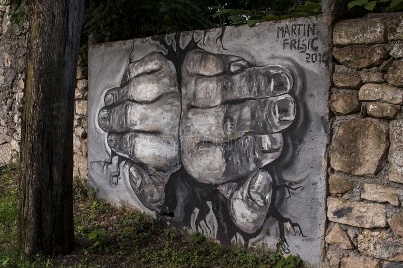 Mostar, palace, bombed, graffiti, mural, Bosnia and Herzegovina, Europe, street art, skyline, Bosnian War. Bosnia, 07/07/2018: a mural on the surrounding wall of stock image