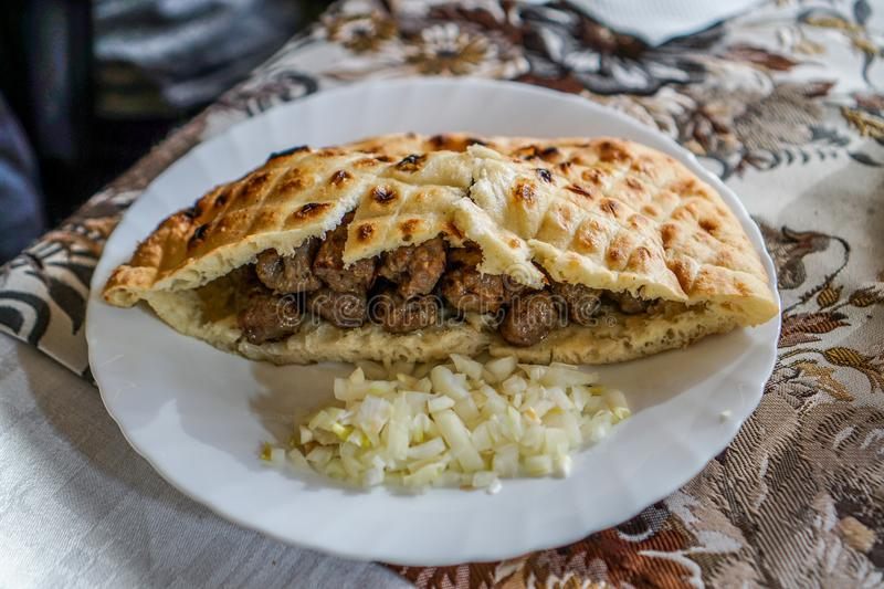 Bosnian Cevapcici in Bosnia. Eating very good Bosnian Cevapcici in Mostar, Bosnia - Turkish Food stock images