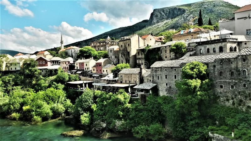 Bosnian city of Mostar. Mostar is a city and municipality in southern Bosnia and Herzegovina. Inhabited by 105,797 people, it is the most important city in the royalty free stock photography