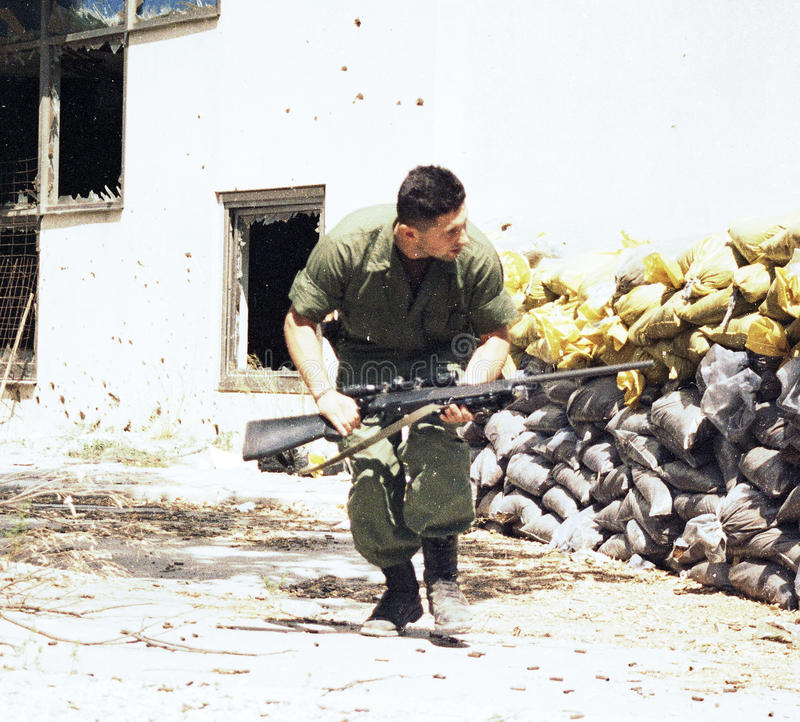 BOSNIAN CIVIL WAR. A Bosnian-Croatian soldier runs for cover during a pitched battle in Mostar, Bosnia, on Monday, May 24, 1993. Photographer: Mark Milstein/ stock photography