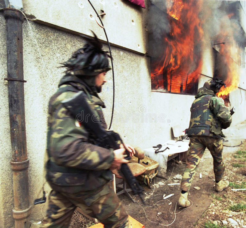 BOSNIAN CIVIL WAR. Italian army troops, in Bosnia as part of the United Nations' UNPROFOR, patrol the streets of Sarajevo, Bosnia, on Monday, March 18, 1996 stock image