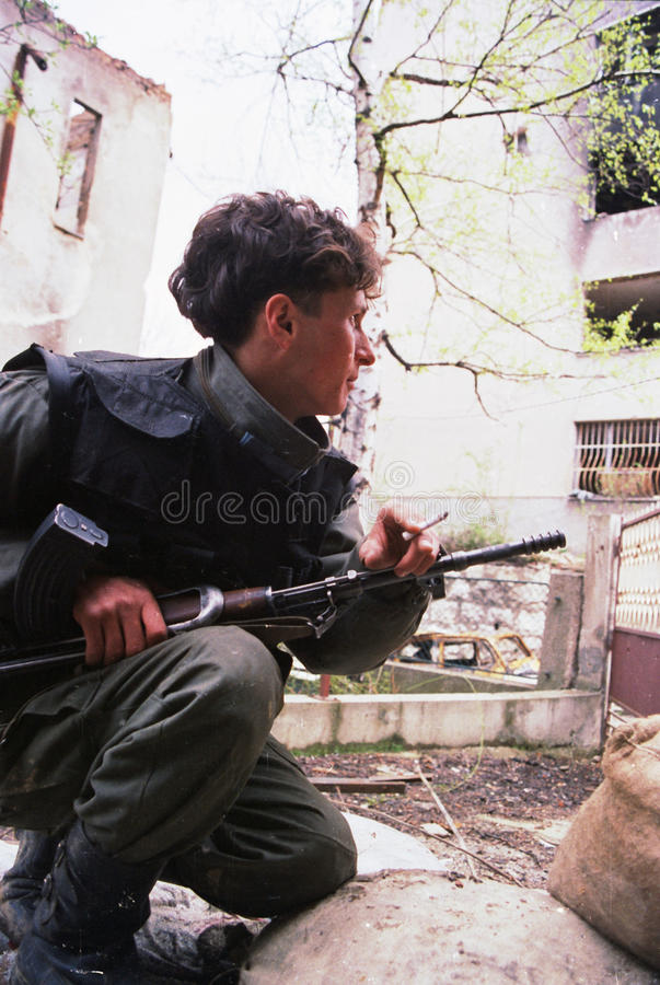 BOSNIAN CIVIL WAR. A lone Bosnian soldier mans a position along the Miljacka River in Sarajevo, Bosnia, on Wednesday, October 22, 1993 Photographer: Mark stock photography