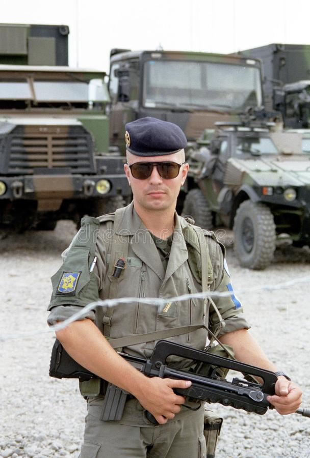 BOSNIAN CIVIL WAR. PLOCE, BOSNIA, 09 AUGUST 1995 - A French mariner stands guard over a supply convoy during the first Anglo-French rapid reaction force stock photography
