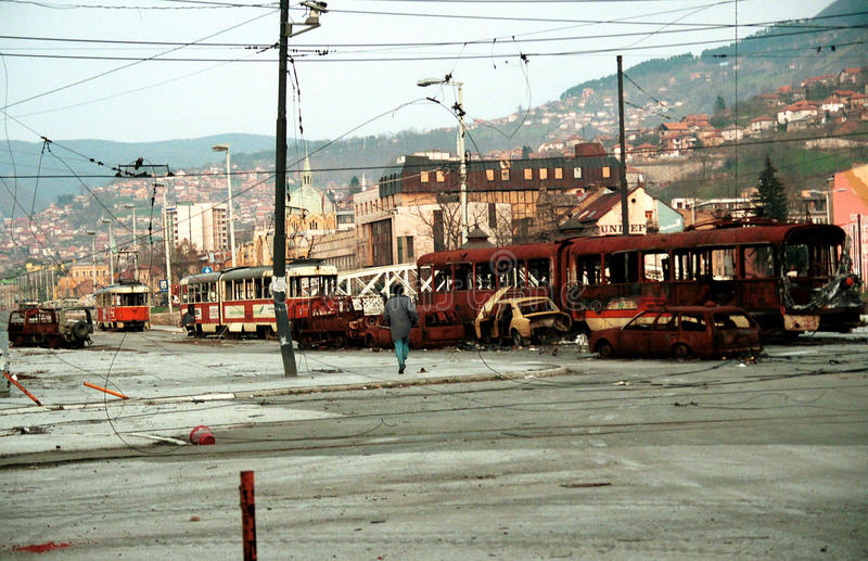 BOSNIAN CIVIL WAR. SARAJEVO, BOSNIA, 04 APRIL 1993 - A Sarajevan braves sniper fire to cross a no-mans land in the besieged Bosnian capital. (C) Photo Credit stock photography