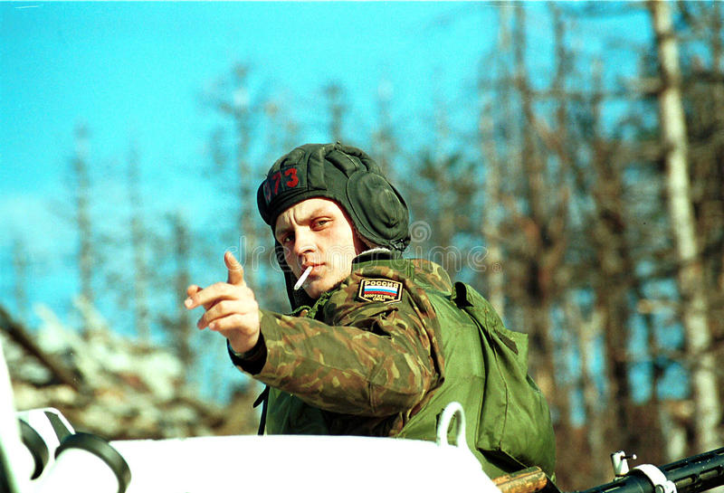 BOSNIAN CIVIL WAR. SARAJEVO, BOSNIA, 01 AUGUST 1993 - A Russian soldier in Bosnia, as part of the United Nations Protection Force (UNPROFOR), stands guard at a royalty free stock photos