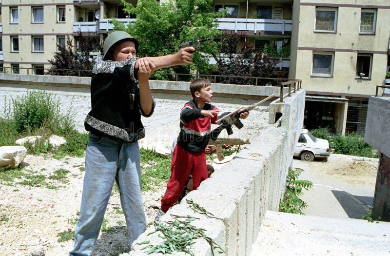 BOSNIAN CIVIL WAR. SARAJEVO, BOSNIA, 28 JULY 1993 - Sarajevo children play war in the besiged capial. (C) Photo Credit: Mark Milstein/ Northfoto *** Local stock photos