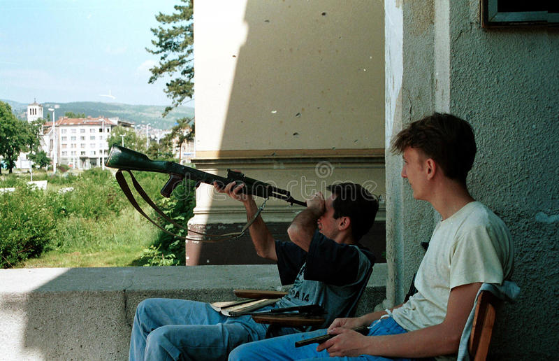 BOSNIAN CIVIL WAR. SARAJEVO, BOSNIA, 22 MAY 1992 - Bosnian government soldiers check their weapons while guarding the national museum in the capital Sarajevo. (C stock photography