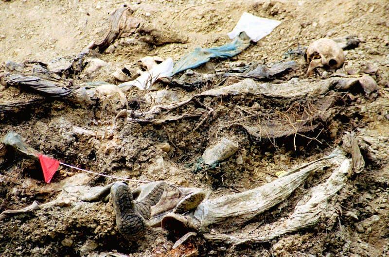 BOSNIAN CIVIL WAR. SREBRENICA, BOSNIA, 12 JUNE 1996 --- The bodies of dozens of Bosnian Moslem men lie at the bottom of a mass grave outside the Bosnian village royalty free stock photography