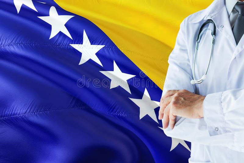 Bosnian Doctor standing with stethoscope on Bosnia Herzegovina flag background. National healthcare system concept, medical theme.  stock images
