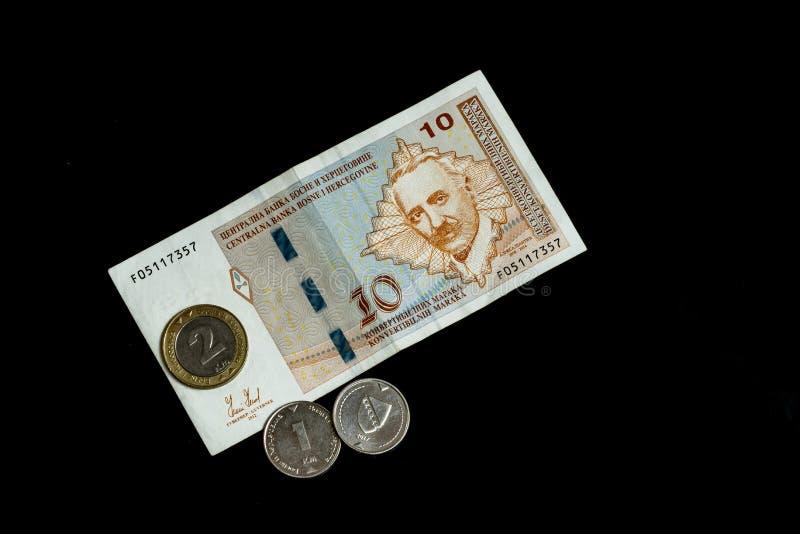 Bosnien och Hercegovina konvertibla fläckanmärkningar och mynt arkivfoton