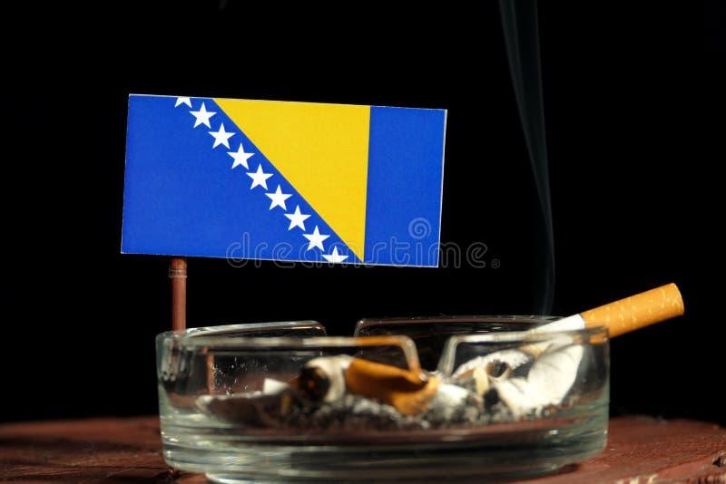 Download Bosnien Und Herzegowina Kennzeichnen Mit Brennender Zigarette Im Aschenbecher, Der Auf Schwarzem Lokalisiert Wird Stockbild - Bild von gesundheit, land: 96935113