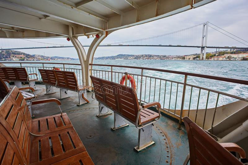 Bosphorus cruise on the ferry. Empty shops overlooking the bay, boat, istanbul, sea, ship, transport, travel, turkey, turkish, asia, board, city, europe royalty free stock photo