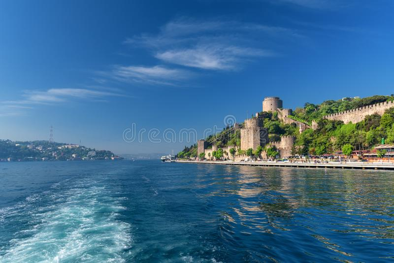 The Bosphorus and Rumeli fortress, Istanbul Turkey. Waterfront view of Rumeli Hisari fortress on the coast of the Bosphorus in Istanbul, Turkey. Located on the royalty free stock images
