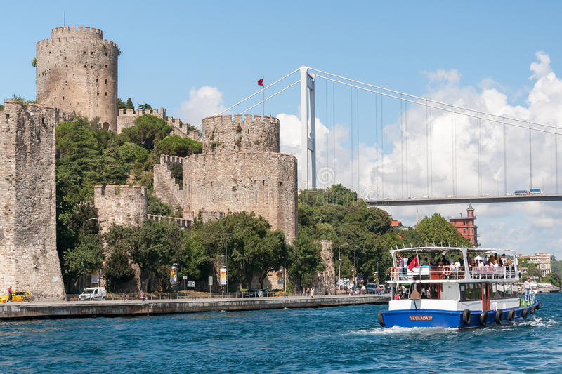 Bosphorus strait, Turkey. Cruise ship with tourists and Rumelian Castle at the shore of the Bosphorus strait, European side, Istanbul stock images