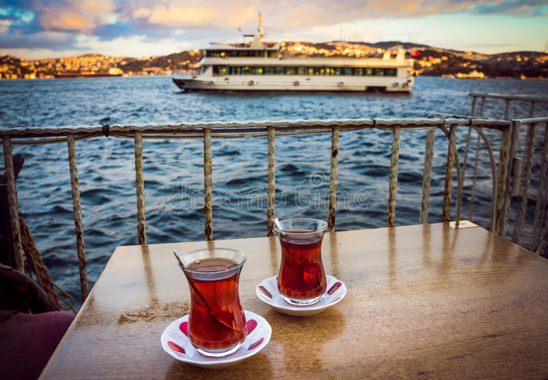 Bosphorus tea. Two glasses of turkish tea on the table with Bosphorus on the background in Istanbul, Turkey stock photo