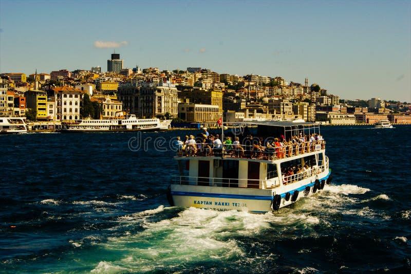 Bosphorus tour boat with Istanbul skyline stock photos