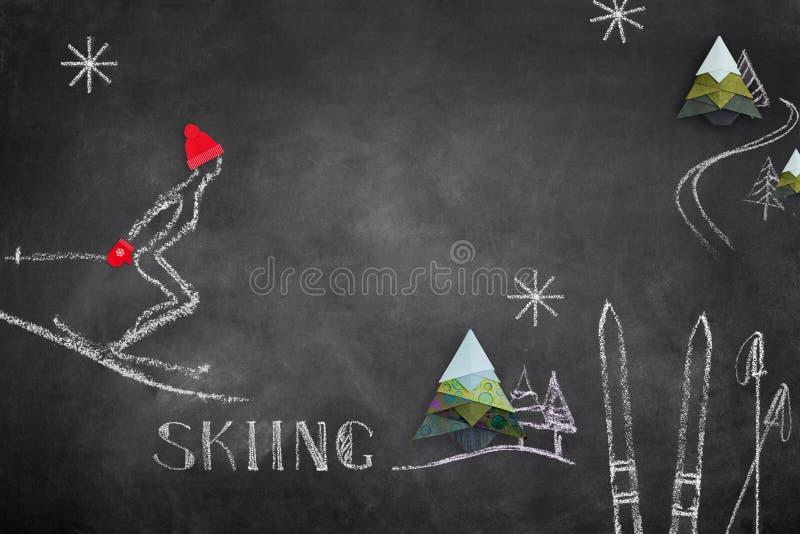 Bosquejo del esquiador y de la papiroflexia en tablero negro fotografía de archivo